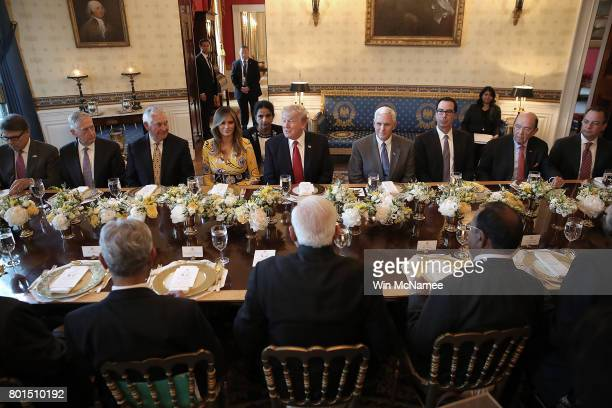 S President Donald Trump flanked by first lady Melania Trump and Vice President Mike Pence delivers remarks before dinner with Indian Prime Minister...