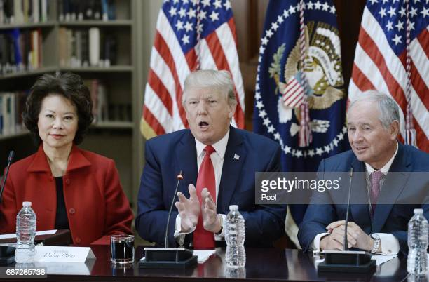 President Donald Trump flanked by Secretary of Transportation Elaine Chao and Stephen A Schwarzman Chairman CEO and CoFounder of Blackstone speaks...