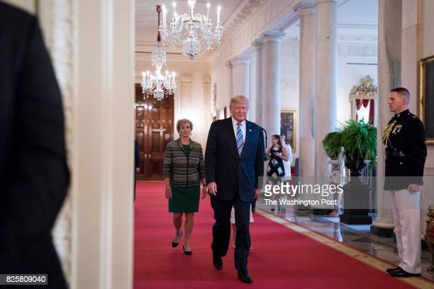 President Donald Trump flanked by Small Business Administration Administrator Linda McMahon left and his daughter Ivanka Trump walk in to speak to...