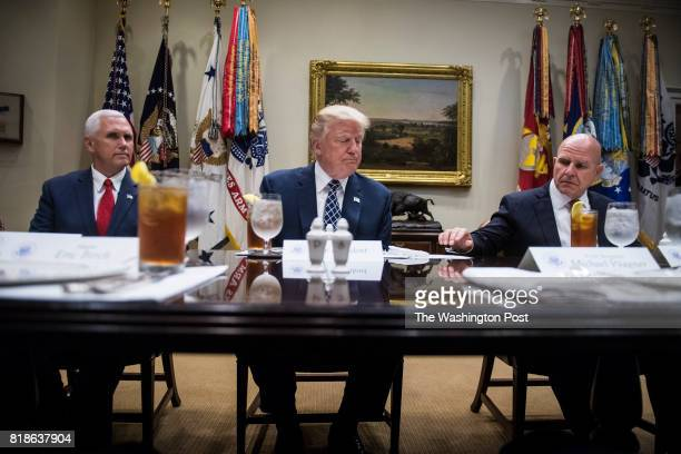 President Donald Trump flanked by Vice President Mike Pence and National Security Adviser HR McMaster pauses as he speaks to reporters and members of...