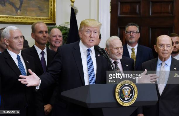 US President Donald Trump flanked by VicePresident Mike Pence Apollo 11 astronaut Buzz Aldrin and Commerce Secretary Wilbur Ross speaks before...