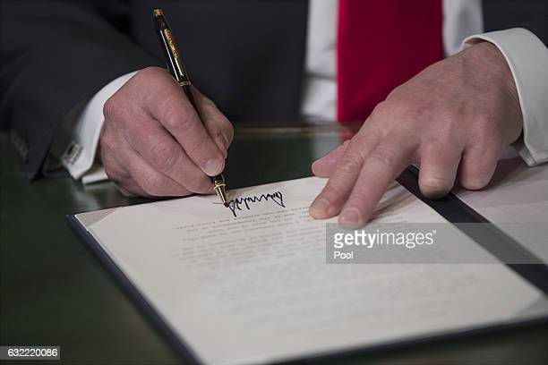 President Donald Trump formally signs his cabinet nominations into law in the PresidentÕs Room of the Senate at the Capitol in Washington January 20...
