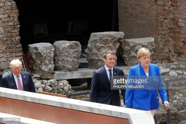 US President Donald Trump French President Emmanuel Macron and German Chancellor Angela Merkel arrive to pose for a family picture as they attend the...