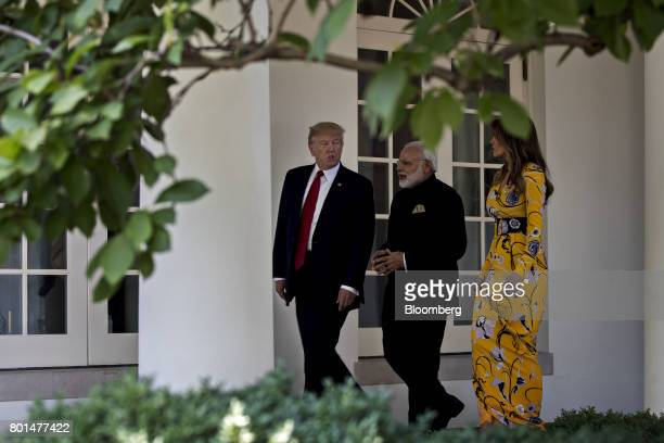 US President Donald Trump from left Narendra Modi India's prime minister and US First Lady Melania Trump walk through the Colonnade of the White...