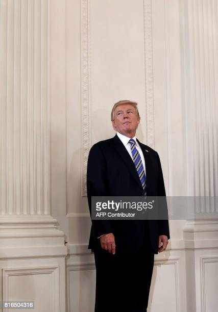 President Donald Trump geestures during a Made in America product showcase event in the East Room of the White House in Washington DC on July 17 2017...