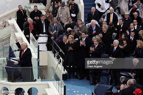 S President Donald Trump gestures after delivering his inaugural address on the West Front of the US Capitol on January 20 2017 in Washington DC In...