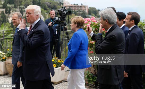 US President Donald Trump gestures along with European Council President Donald Tusk German Chancellor Angela Merkel Italian Prime Minister Paolo...