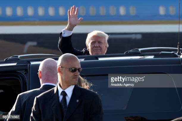 President Donald Trump gestures as he arrives at Fiumicino airport in Rome Italy on May 23 2017