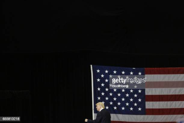 US President Donald Trump gestures as he arrives for a rally at the Kentucky Exposition Center in Louisville Kentucky US on Monday March 20 2017...