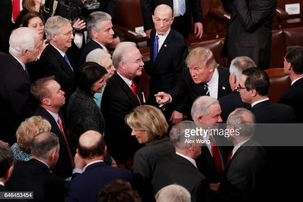 S President Donald Trump gestures as he departs after addressing a joint session of the US Congress on February 28 2017 in the House chamber of the...