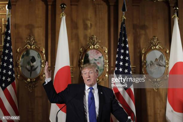 US President Donald Trump gestures as he speaks during a news conference with Shinzo Abe Japan's prime minister not pictured at Akasaka Palace in...