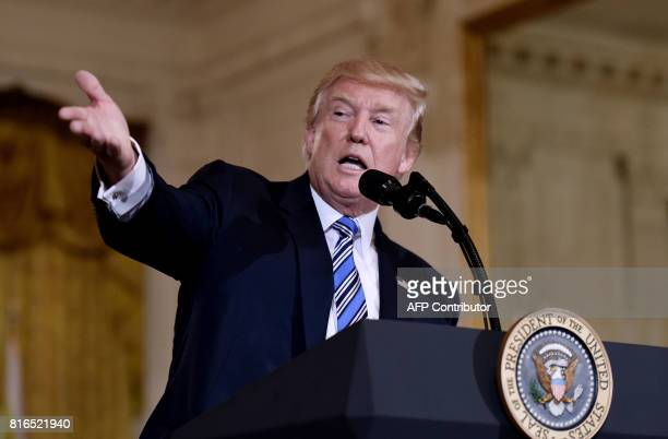President Donald Trump gestures during a Made in America product showcase event at the White House in Washington DC on July 17 2017 / AFP PHOTO /...