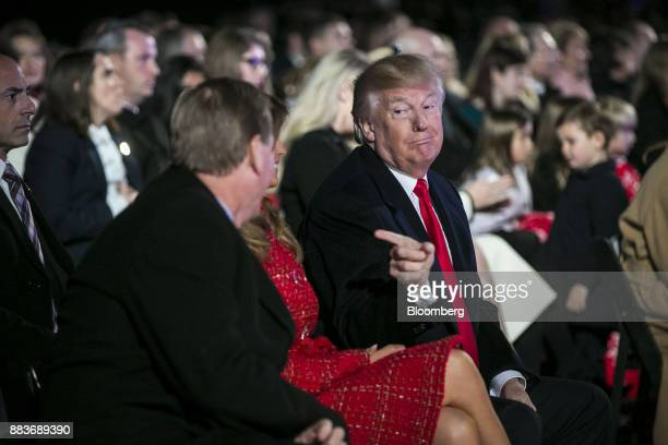 US President Donald Trump gestures during the 95th Annual National Christmas Tree Lighting in Washington DC US on Thursday Nov 30 2017 The White...