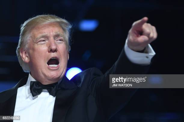 US President Donald Trump gestures during the Freedom Ball at the Washington DC Convention Center following Donald Trump's inauguration as the 45th...