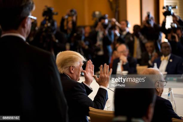 US President Donald Trump gestures during the G7 Summit expanded session in Taormina Sicily on May 27 2017