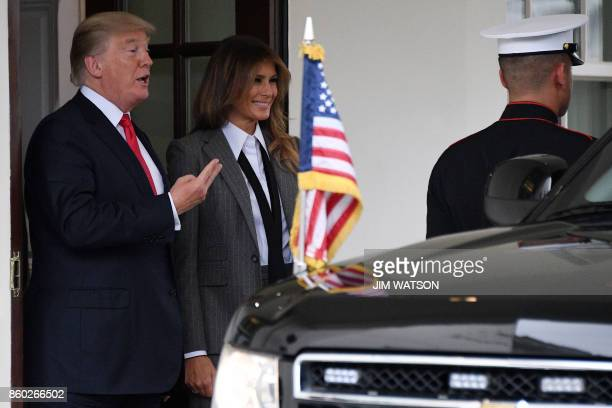 US President Donald Trump gestures next to First Lady Melania Trump as they say goodbye to the Canadian Prime Minister and his wife following their...