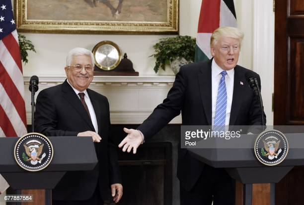 President Donald Trump gives a joint statement with President Mahmoud Abbas of the Palestinian Authority in the Roosevelt Room of the White House on...