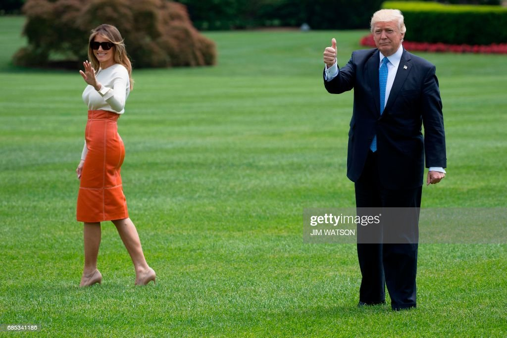 US President Donald Trump (R) gives a thumbs up as he and First Lady Melania Trump (L) depart the White House in Washington, DC, May 19, 2017. /