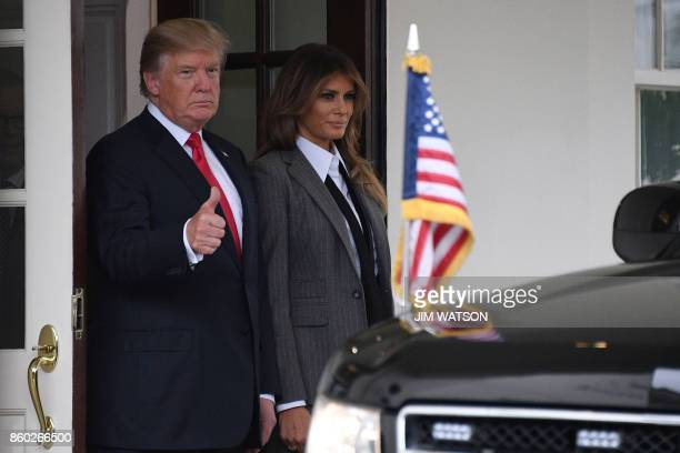 US President Donald Trump gives a thumbs up next to First Lady Melania Trump as they say goodbye to the Canadian Prime Minister and his wife...