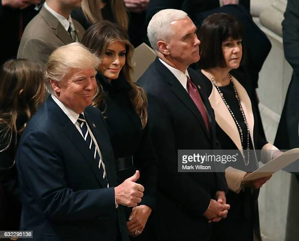 S President Donald Trump gives thumbs up while standing with his wife first lady Melania Trump Vice President Mike Pence and his wife Karen Pence...