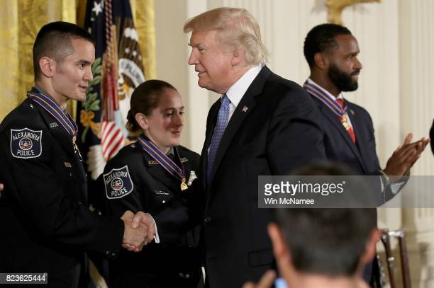 S President Donald Trump greets Alexandria Police officer Alex Jensen an event in the East Room of the White House recognizing the first responders...