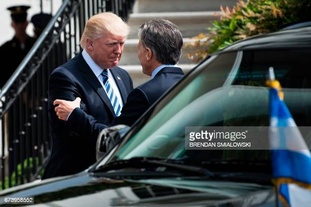 US President Donald Trump greets Argentina's President Mauricio Macri outside the White House April 27 2017 in Washington DC / AFP PHOTO / Brendan...