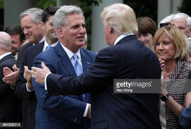 S President Donald Trump greets House Majority Leader Rep Kevin McCarthy during a Rose Garden event May 4 2017 at the White House in Washington DC...