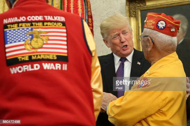 US President Donald Trump greets members of the Native American code talkers during an event in the Oval Office of the White House on November 27...