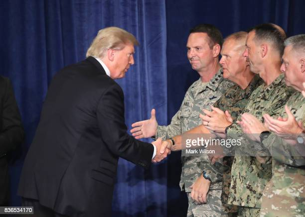 S President Donald Trump greets military leaders before his speech on Afghanistan at the Fort Myer military base on August 21 2017 in Arlington...