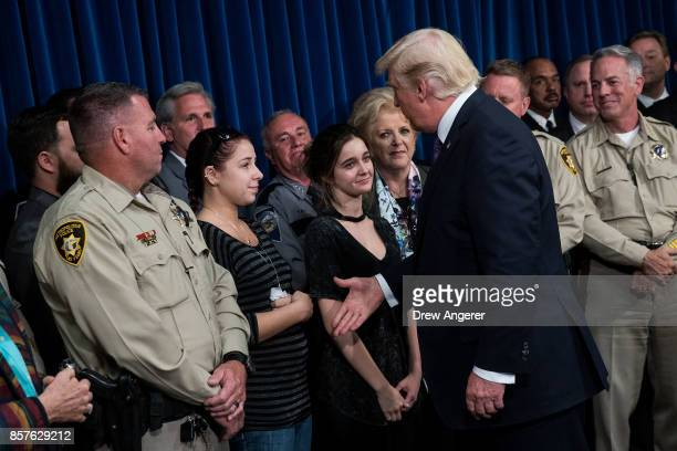 President Donald Trump greets police officers and family members after speaking at Las Vegas Metropolitan Police Department headquarters October 4...