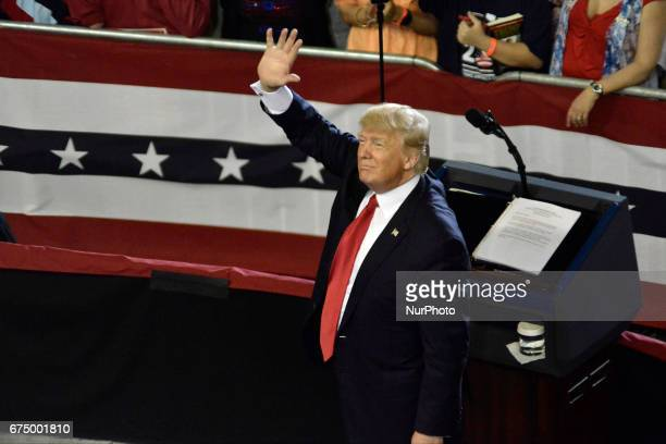 President Donald Trump greets supporters at a April 29 2017 rally in Harrisburg PA The Make America Great Again event is to celebrate the presidents...