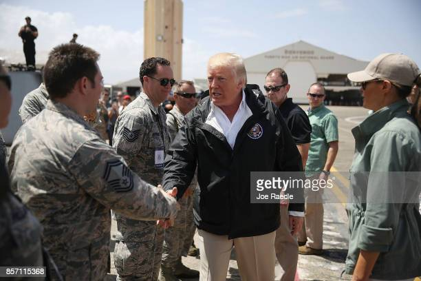 President Donald Trump greets US Air Force airmen as he arrives at the Muniz Air National Guard Base as he makes a visit after Hurricane Maria hit...