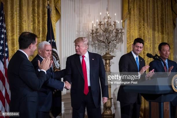 President Donald Trump greets Vice President Mike Pence Wisconsin Gov Scott Walker House Speaker Paul Ryan of Wis and Terry Gou president and chief...