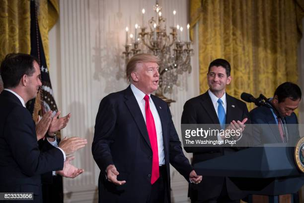 President Donald Trump greets Vice President Mike Pence Wisconsin Gov Scott Walker and House Speaker Paul Ryan of Wis after announcing the first US...