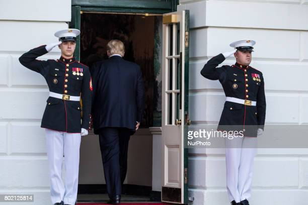 President Donald Trump heads back in to the White House after the departure of Prime Minister Narendra Modi of India as he left the South Portico of...