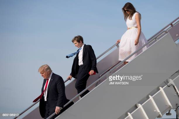 US President Donald Trump his son Barron and First Lady Melania Trump step off Air Force One at Andrews Air Force Base Maryland April 16 2017 / AFP...