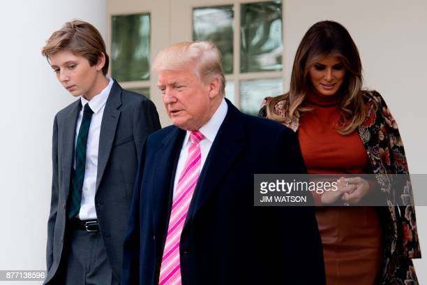 US President Donald Trump his son Barron and First Lady Melania Trump arrive for the pardoning of the Thanksgiving turkey Drumstick in the Rose...