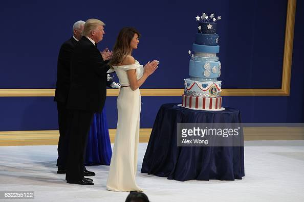 President Donald Trump his wife First Lady Melania Trump Vice President Mike Pence and Karen Pence clap before cutting the cake during A Salute To...