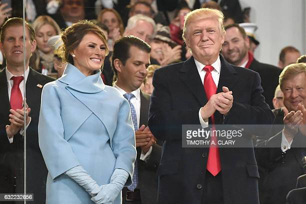 US President Donald Trump his wife Melania and other family members arrive in the official tribune to review marching band performing in the...