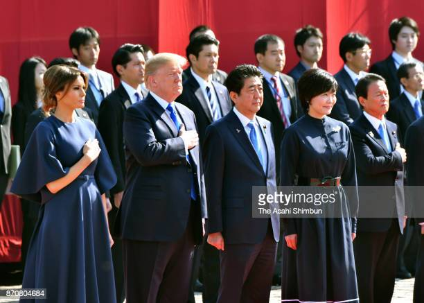 US President Donald Trump his wife Melania Japanese Prime Minister Shinzo Abe and his wife Akie attend the welcome ceremony at the Akasaka State...