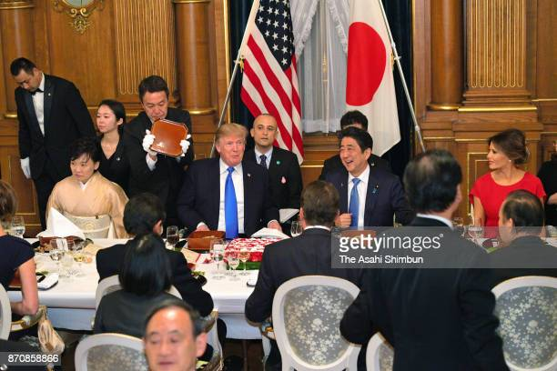 US President Donald Trump his wife Melania Japanese Prime Minister Shinzo Abe and his wife Akie attend the dinner hosted by Abe at the prime...