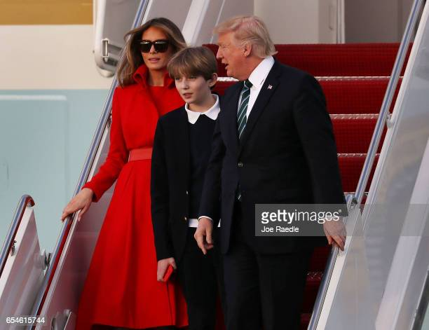 S President Donald Trump his wife Melania Trump and their son Barron Trump arrive together on Air Force One at the Palm Beach International Airport...