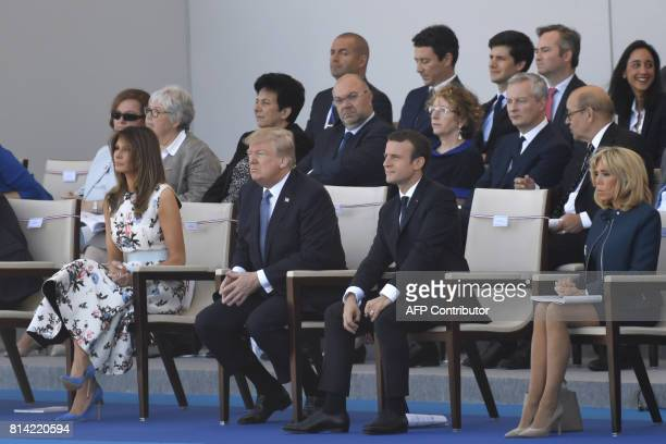 US President Donald Trump his wife US First Lady Melania Trump French President Emmanuel Macron and his wife Brigitte Macron attend the annual...