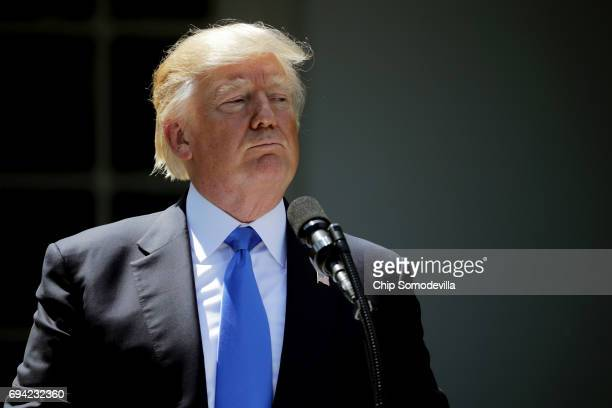 S President Donald Trump holds a joint news conference with Romanian President Klaus Iohannis in the Rose Garden at the White House June 9 2017 in...
