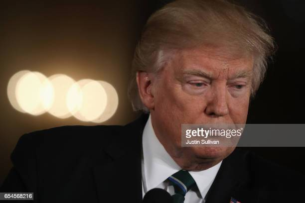 S President Donald Trump holds a joint press conference with German Chancellor Angela Merkel in the East Room of the White House on March 17 2017 in...