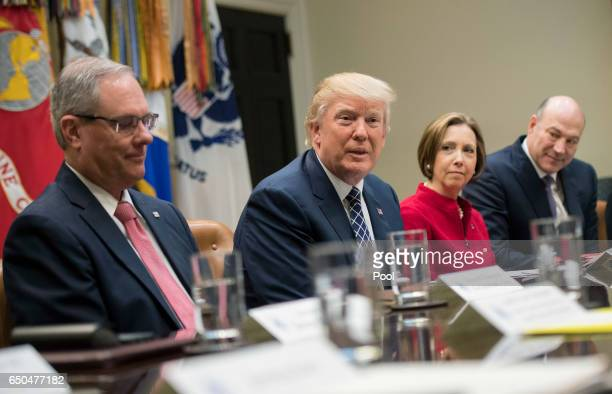 President Donald Trump holds a National Economic Council listening session with the CEOs of small and community banks in the Roosevelt Room at the...