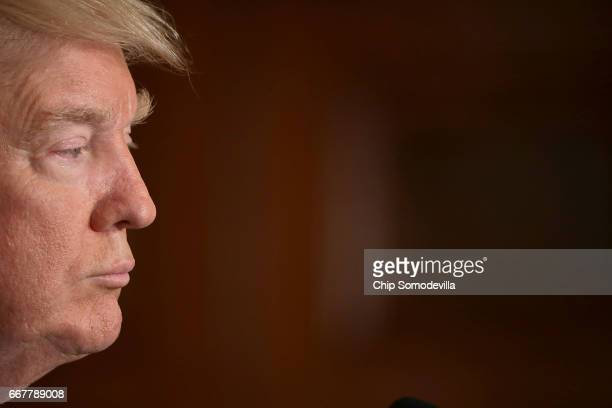 S President Donald Trump holds a news conference with NATO Secretary General Jens Stoltenberg in the East Room of the White House April 12 2017 in...