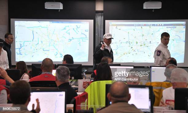 US President Donald Trump holds up a fist as he walks through the the Texas Department of Public Safety Emergency Operations Center in Austin Texas...