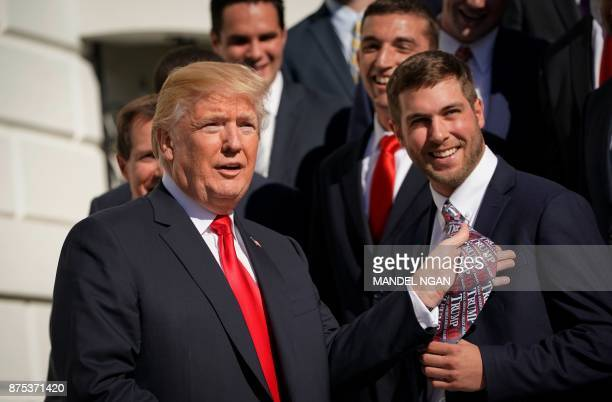 US President Donald Trump holds up the tie of University of Maryland lacrosse player Dylan Maltz during an event honoring NCAA national championship...