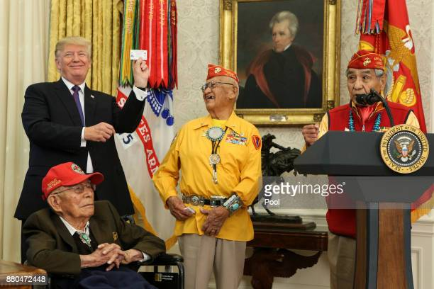 US President Donald Trump hosts members of the Native American code talkers during an event in the Oval Office of the White House on November 27 2017...